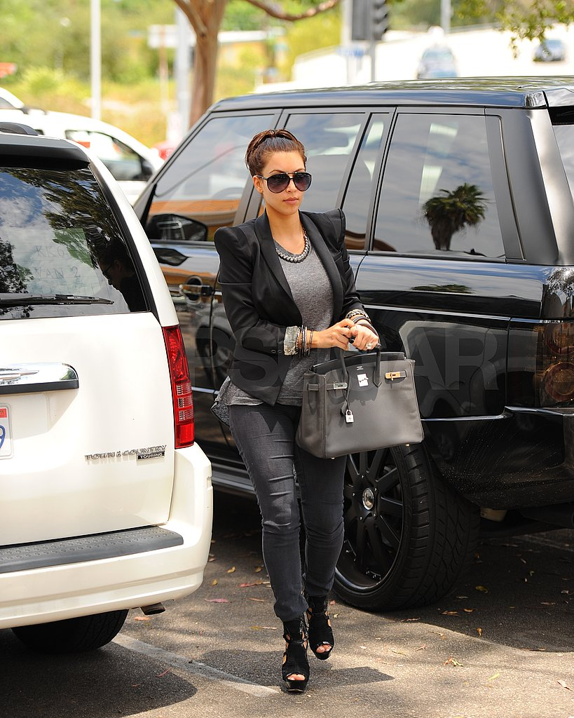 Kim Kardashian pulled back her hair for a casual look.