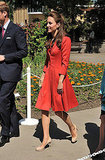 Kate Middleton wore a red coat.