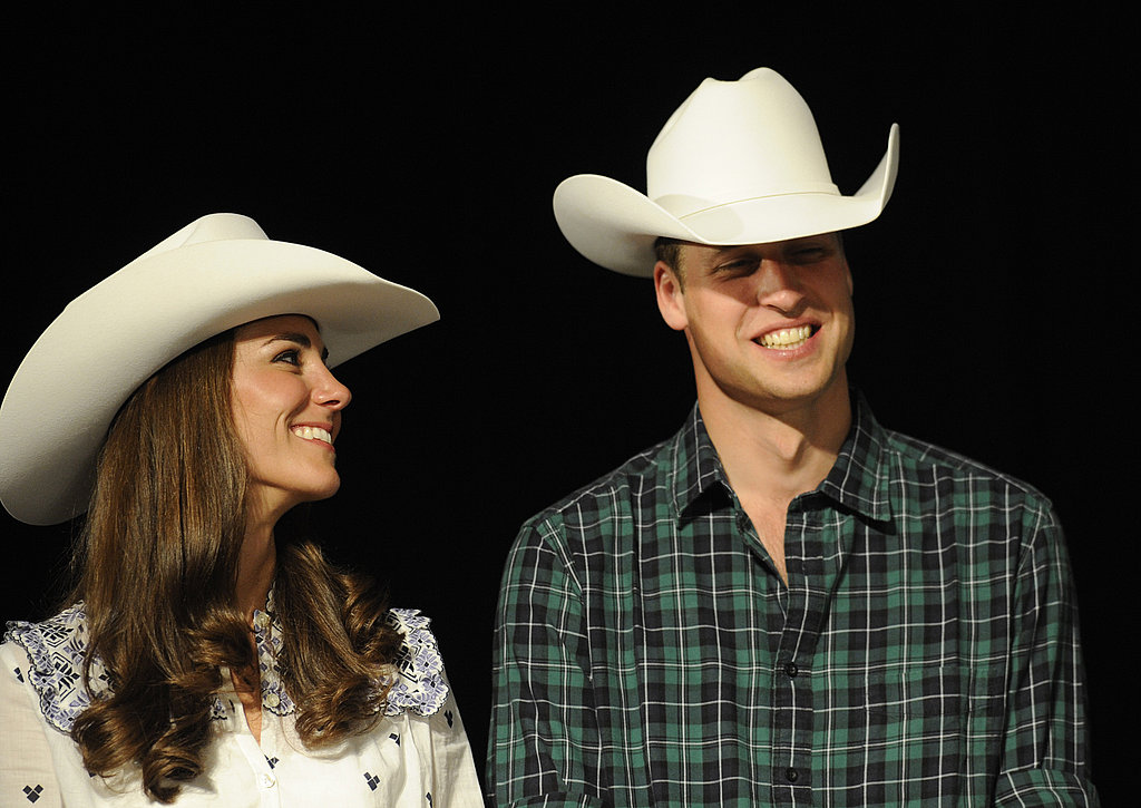 Prince William and Kate Middleton sport matching white cowboy hats at a Calgary rodeo demonstration on Thursday evening.