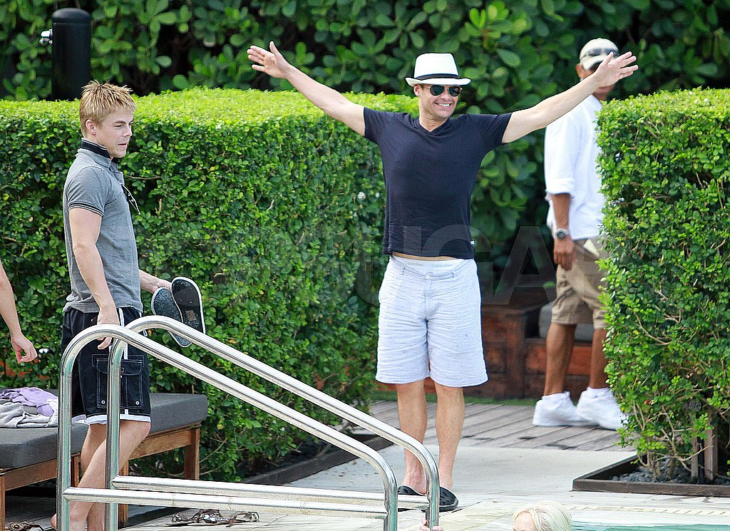 Ryan Seacrest by the pool in Miami.