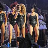 Beyoncé Knowles laughs on stage.