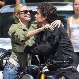 Orlando Bloom hugs Kate Bosworth on his bike.