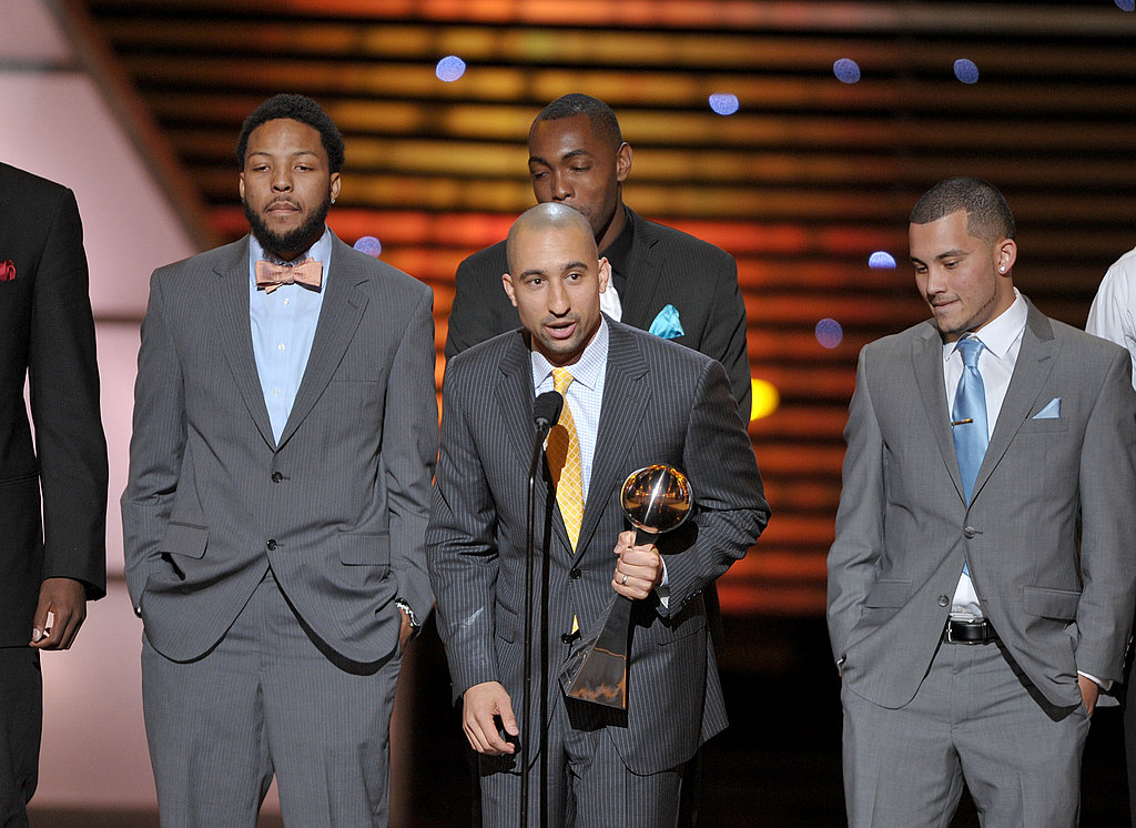 Rams head coach Shaka Smart accepted the award for best upset with the members of his team.
