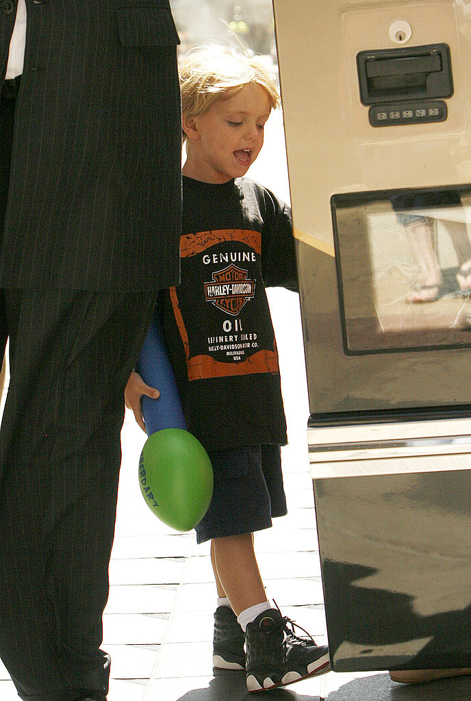 Jayden James carried a pool toy.