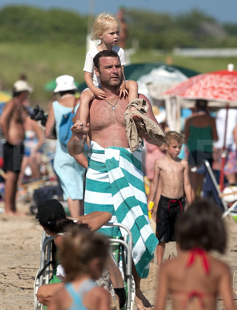 Shirtless Liev Schreiber at the beach with son Sasha.