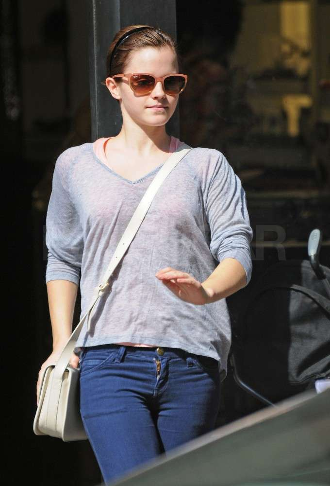 Emma Watson shopped in sunglasses.