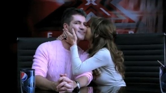 Video: Simon Cowell Pokes Fun at Idol and Kisses Paula Abdul in First X-Factor Promo