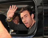 Matthew Lewis waves out the car in Canada.