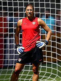 Hope Solo strikes a pose during practice.
