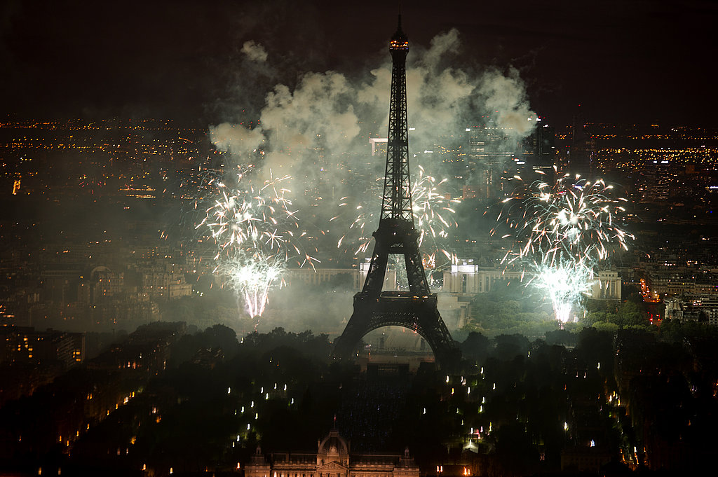 Fireworks sparkle next to the Eiffel Tower for Bastille Day.