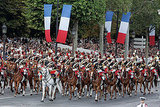 Horsemen of the French Republican Guard ride through the Champs-Elysees parade.