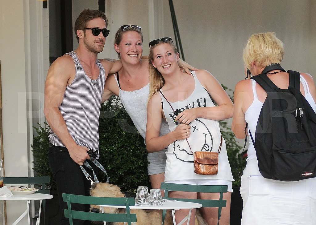 Ryan Gosling poses with fans.
