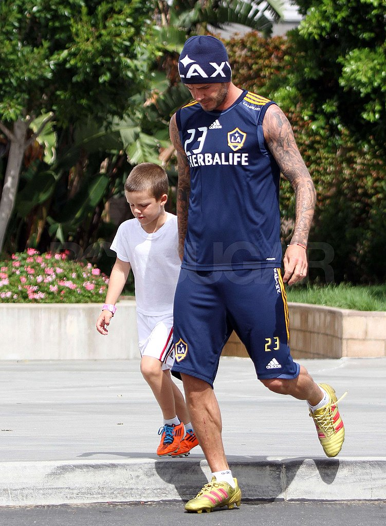 David Beckham and Cruz Beckham walked together.