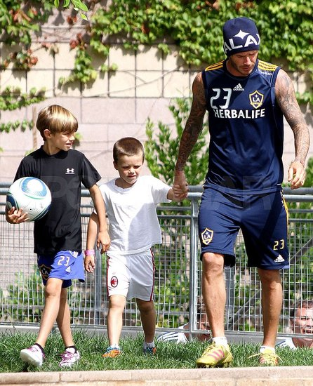 Romeo Beckham carried a soccer ball as David Beckham and Cruz Beckham followed close behind.