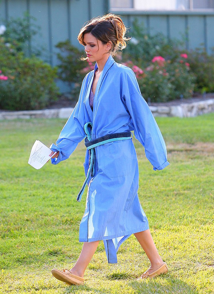 Rachel Bilson covered up under a blue robe.