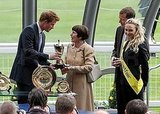 Prince Harry presents a trophy.