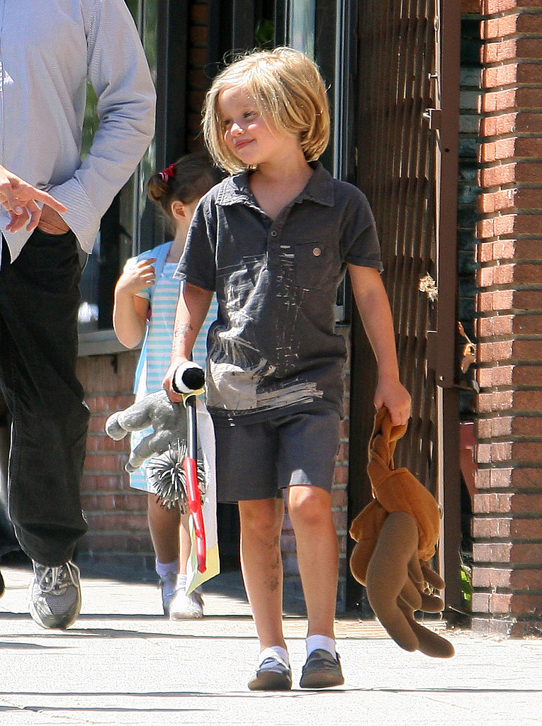 Shiloh Jolie-Pitt with a pitchfork.