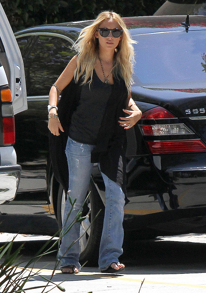 Nicole Richie wore a vest over her dark tank.