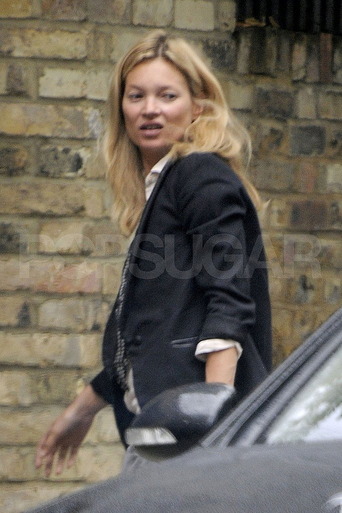 Kate Moss returns home.