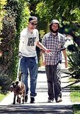 Robert Pattinson and Tom Sturridge laugh on a walk.