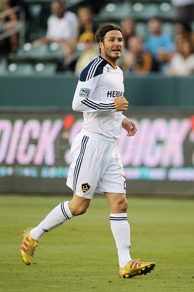 David Beckham runs on the soccer field.