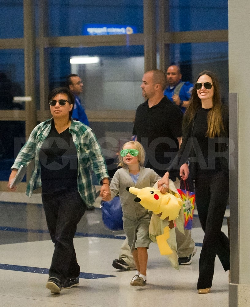 Shiloh Jolie-Pitt with a stuffed animal.