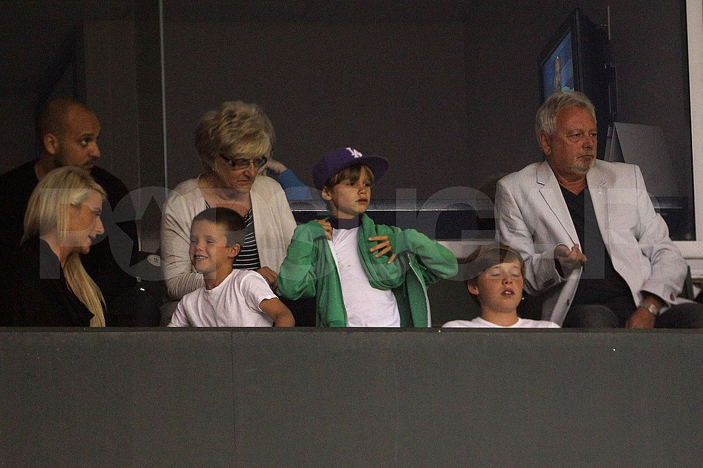 Romeo, Cruz, and Brooklyn Beckham in a luxury box.