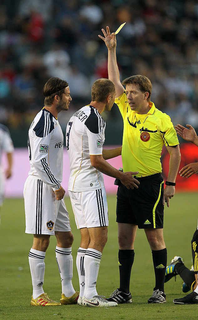 David Beckham gets a yellow card.