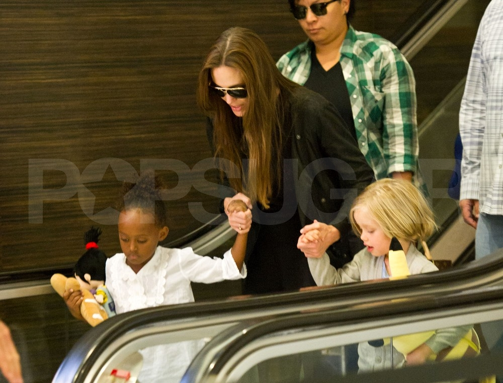 Angelina Jolie on an escalator with Shiloh Jolie-Pitt and Zahara Jolie-Pitt.
