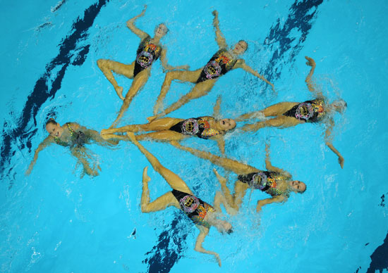 Canadian synchronized swimmers compete at the world championships in China.