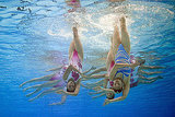 China's swimmers compete upside down at the FINA World Championships.