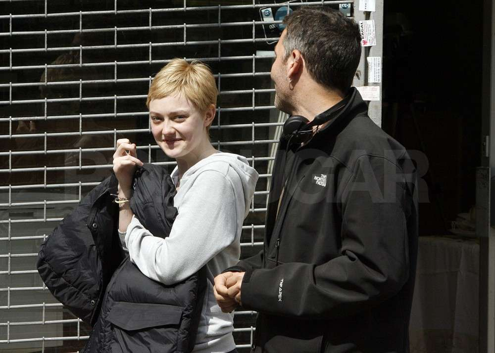 Dakota Fanning carried a coat.