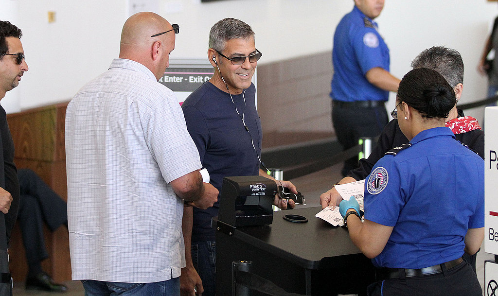 George Clooney goes through airport security.