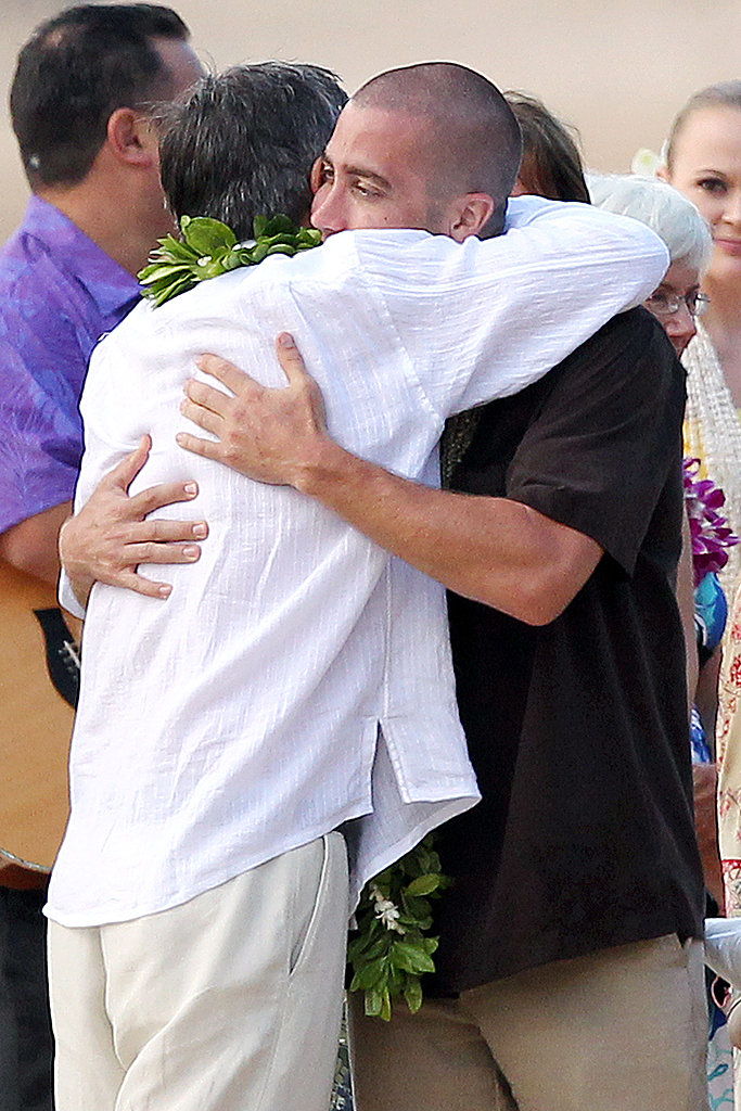 Jake Gyllenhaal and Stephen Gyllenhaal hug.