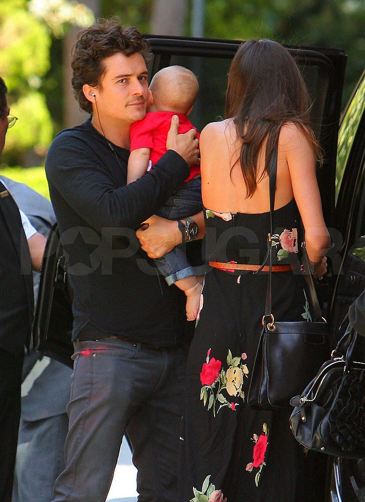Orlando Bloom cradled baby Flynn, as Orlando and Miranda Kerr headed to their car.