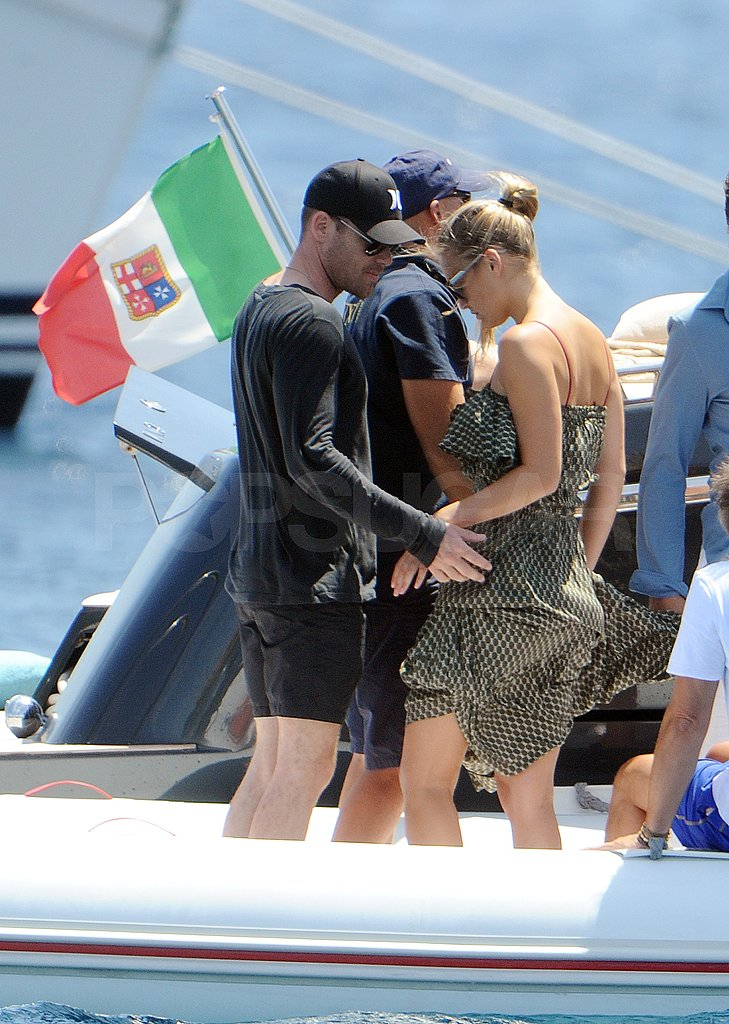 Bar Refaeli wore a long dress yachting off the coast of Italy.