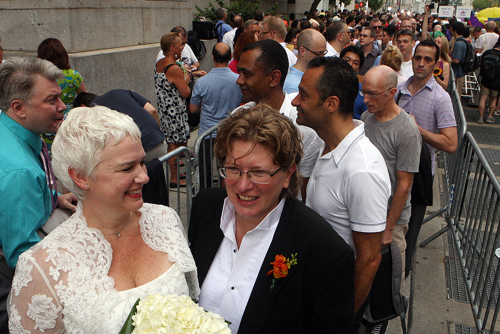 Robyn Selman and Karin Cook wait with others to get married at the Manhattan city clerk's office.