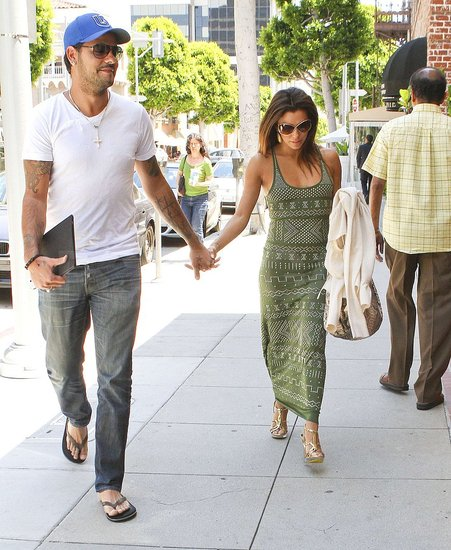 Eduardo Cruz smiled as he held hands with Eva Longoria.