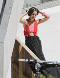 Katie Holmes Bares Her Abs Striking a Sexy Pose at a Photo Shoot