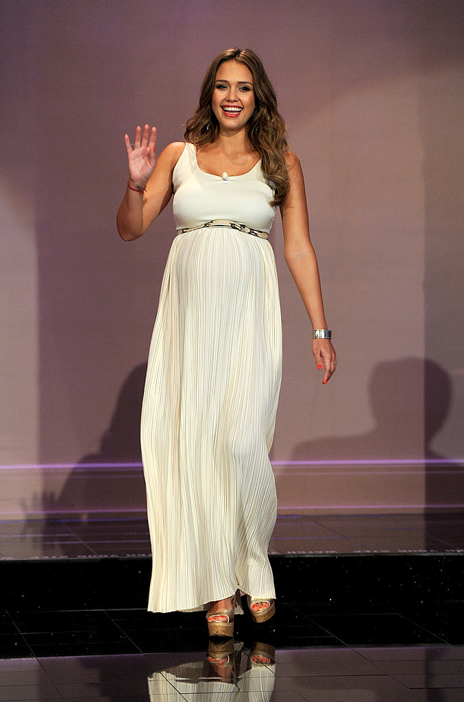 Jessica wore a bump-hugging maxi dress.