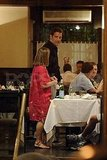 Clive Owen at a restaurant in Spain.