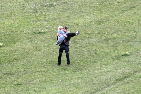 Jeremy Irvine gave Dakota Fanning a lift.