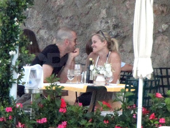Reese Witherspoon and Jim Toth smile at lunch during their honeymoon.