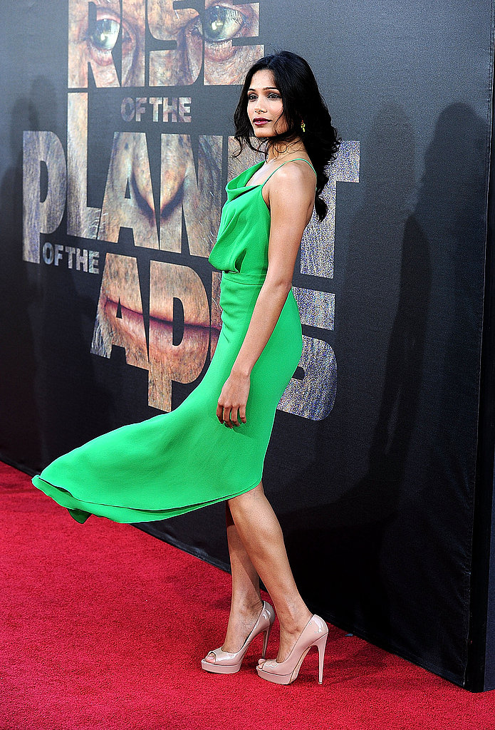 A windswept shot of Freida shows off her Brian Atwood nude pumps.