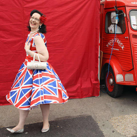 A festival-goer smiles in her patriotic dress.