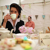 A woman sips tea at London's Vintage Festival.