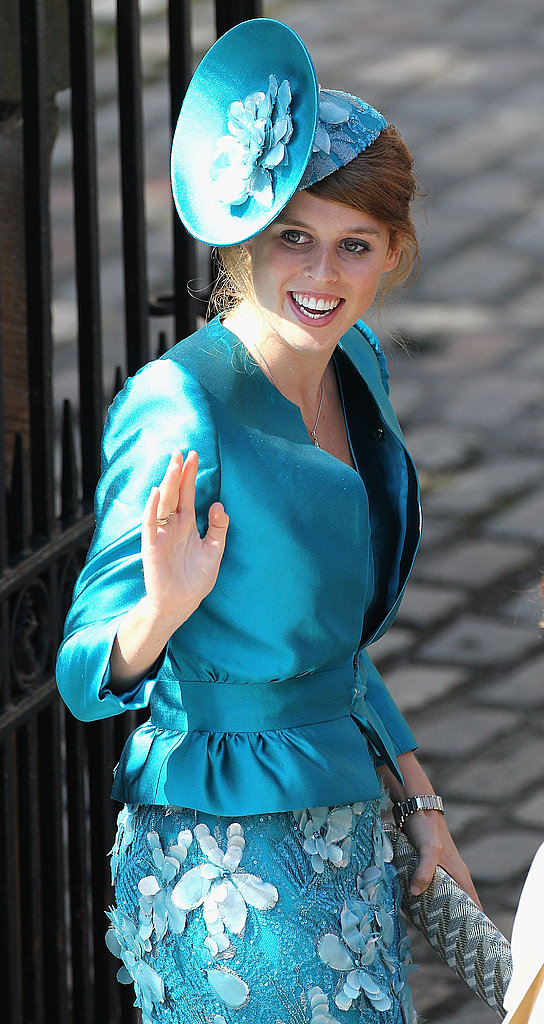 Princess Beatrice waves outside Zara Phillips and Mike Tindall's wedding.