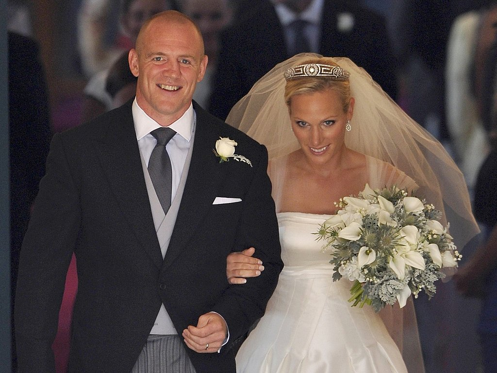The happy couple Zara Phillips and Mike Tindall walk out from the ceremony.
