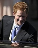 Prince Harry smiles at the wedding of his first cousin Zara Phillips.