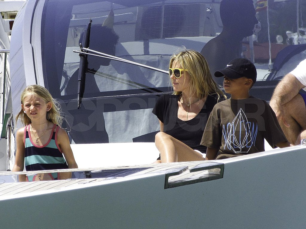 Heidi sat with Leni and Henry on a boat.